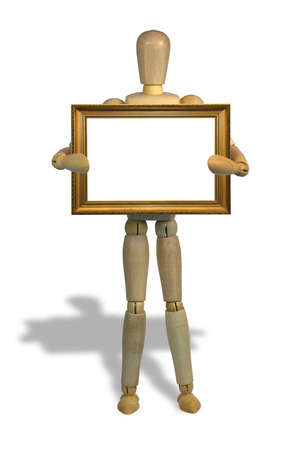 Wooden mannequin holding a gold picture frame on a white background with shadow. photo