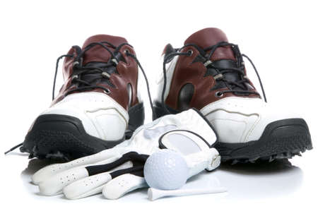 Golf shoes,Ball,Glove and Tee. High key shot. photo