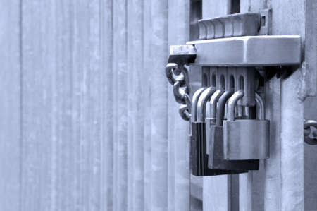 safe and sound: Five padlocks on a metal gate, concept shot for security related matters. Stock Photo