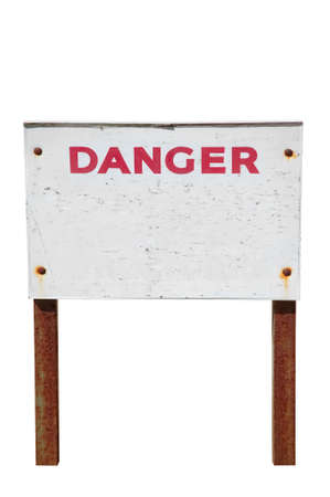 Old weathered Danger sign with peeling paint and rusty legs, isolated on white with clipping path. photo