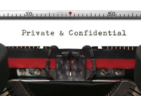 Private and Confidential on an old typewriter in genuine typescript. photo