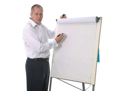 informal clothing: High key shot of a businessman about to write a presentation on a blank flip chart. Stock Photo
