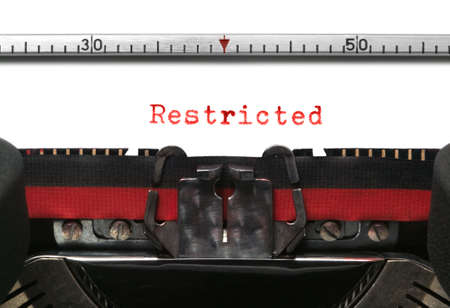 Restricted on an old typewriter in genuine red typescript