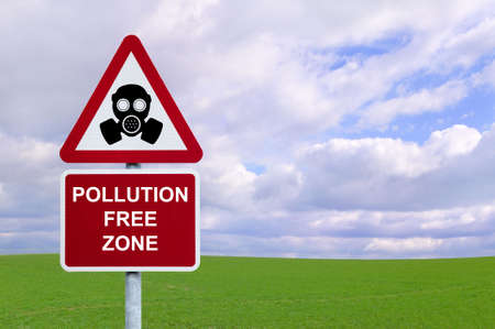 cfc: Image of a sign for a Pollution Free Zone against a green field and blue cloudy sky.  Environmental and Conservation concepts.