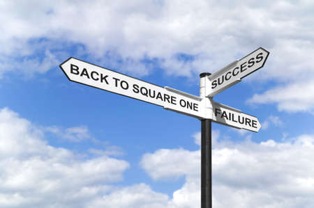 winning idea: Concept image of a signpost with Back to Square One, Success and Failure against a blue cloudy sky. Stock Photo
