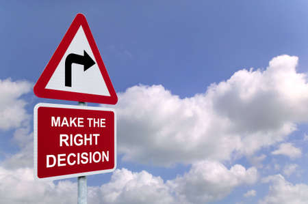 Make the Right Decision on a signpost against a blue cloudy sky. Stock Photo - 2802251