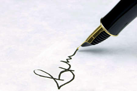 Signature on watermarked textured paper using a gold nibbed fountain pen. Focal point is on the text. Stock Photo - 2818543