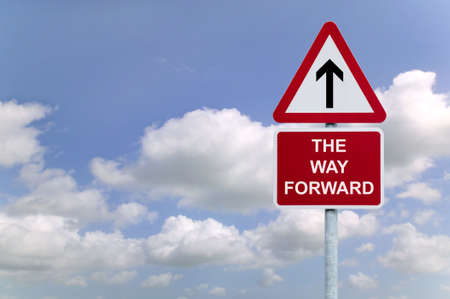 Signpost The Way Forward against a blue cloudy sky background, business concept image. photo