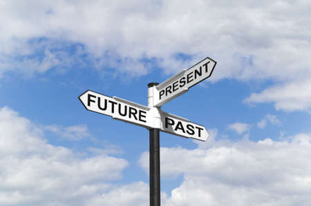 moment: Concept image of a Future Past & Present signpost against a blue cloudy sky Stock Photo