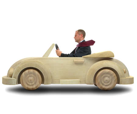 Concept image of a businessman driving to work in his environmentally friendly wooden car. Stock Photo - 2839943