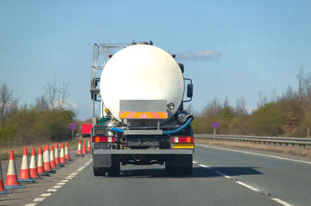 carriageway: Rear view of a fuel tanker driving along a dual carriageway Stock Photo