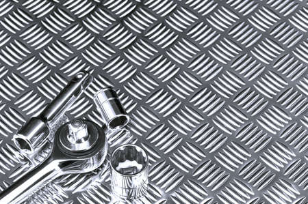 workbench: Mechanical background image of socket set on a checkerplate workbench.