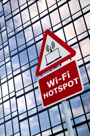 hotspot: Wireless technology concept image of a WiFI Hotspot sign outside a modern office building. (The wireless laptop icon was designed by myself.)