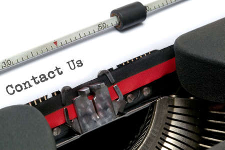 Contact Us typed on an old typewriter, shot at an angle. Stock Photo