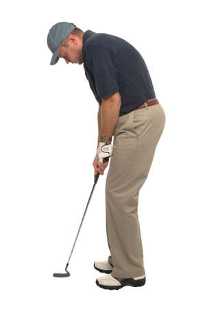 Studio shot of a golfer lining up his putter.