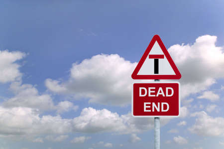 Concept image of a signpost for a Dead End againsta blue cloudy sky. Stock Photo - 3377691