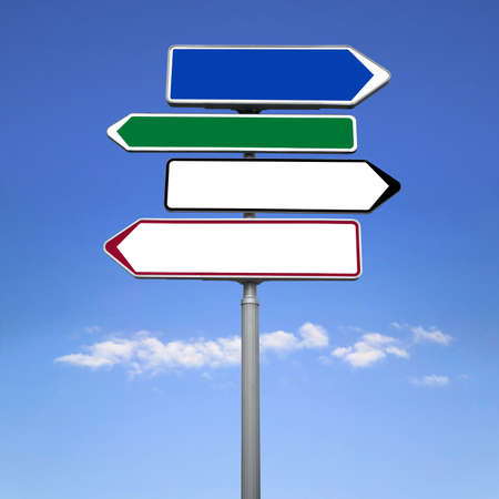 A blank road sign in different colours against a blue sky.