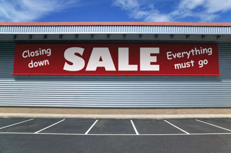 Retail building with a banner on the outside for a closing down sale. Good image for recession concepts.