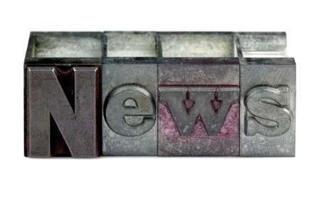 The word News in old letterpress printing blocks isolated on a white background. Stock Photo - 4106243