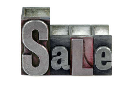 The word Sale in old letterpress printing blocks isolated on a white background. Stock Photo - 4106244