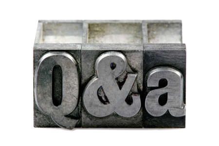 The letters Q&A in old letterpress printing blocks isolated on a white background. Stock Photo - 4106242
