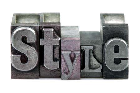 Het woord STYLE in oude boekdruk cliches geïsoleerd op een witte achtergrond. Stockfoto