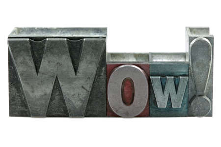 The word WOW! in old letterpress printing blocks isolated on a white background. Stock Photo - 4124497