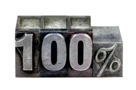 The term 100% in old letterpress printing blocks isolated on a white background. Stock Photo - 4124503
