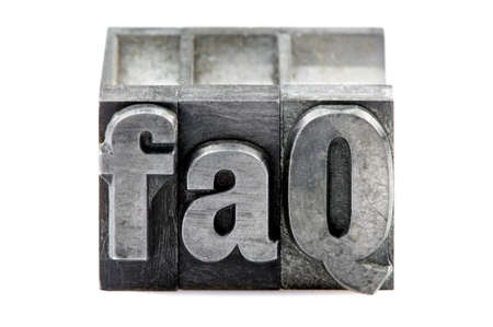 phrase: The phrase FAQ in old letterpress printing blocks isolated on a white background.