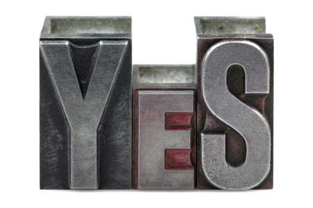 The word Yes in old letterpress printing blocks isolated on a white background. Stock Photo - 4124504