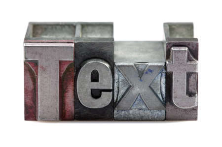The word Text in old letterpress printing blocks isolated on a white background. Stock Photo - 4124507