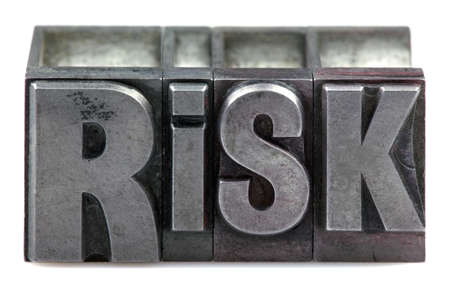 letterpress words: The word Risk in old letterpress printing blocks isolated on a white background. Stock Photo