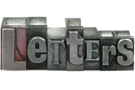 The word LETTERS in old letterpress printing blocks isolated on a white background. Stock Photo - 4145686