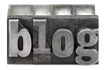 The word Blog in old letterpress printing blocks isolated on a white background. photo