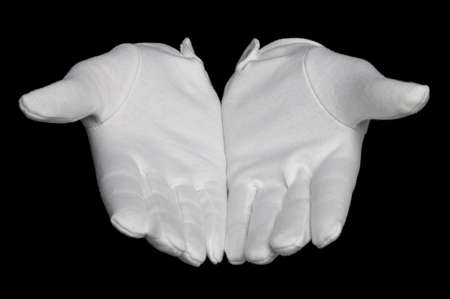 give out: Open hands palms up in white gloves, isolated on a black background.