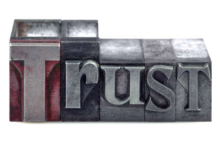 rely: The word Trust in old letterpress printing blocks isolated on a white background. Stock Photo