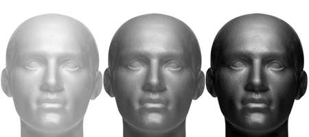 mannequin head: Three mannequin heads in white black and grey, isolated against a white background. Stock Photo