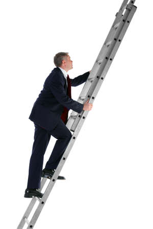 Side view of a businessman climbing a ladder, isolated on a white background. photo