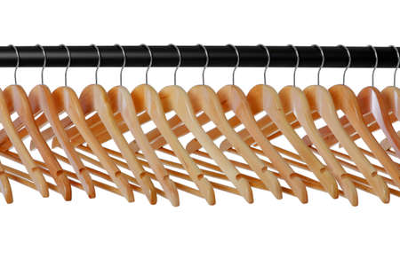 hangers: A line of wooden coat hangers on a clothes rail Stock Photo