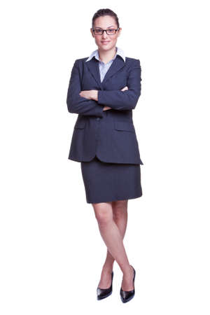 Full length portrait of a smiling businesswoman wearing a skirted suit, isolated on white background. Stock Photo - 4567800