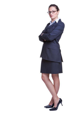 Full length shot of a confident businesswoman dressed in a suit with her arms folded, isolated on white background. Stock Photo - 4567803