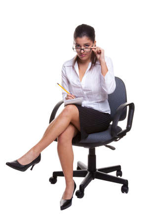 blouse sexy: Secretary wearing glasses sitting on a swivel chair with notebook and pencil, isolated on white background