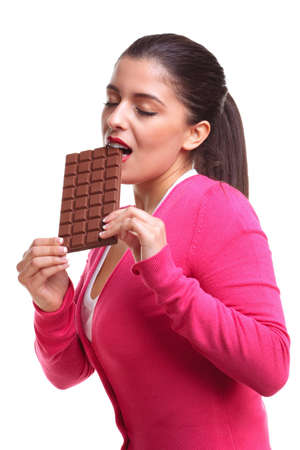 An attractive female enjoying eating a large bar of chocolate, isoalted on qhite background Stock Photo - 4567812
