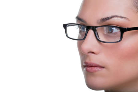 Close up face portrait of a woman wearing glasses isolated on a white background photo