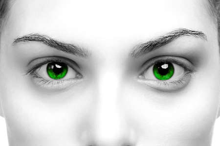 enhanced: High contrast black & white close up of a womans eyes coloured green
