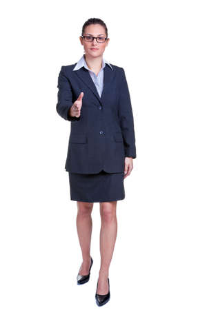Full length portrait of a businesswoman offering to shake your hand, isolated on white background. photo