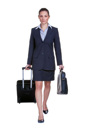 attache case: Businesswoman in suit with suitcase and briefcase, isolated on white background Stock Photo