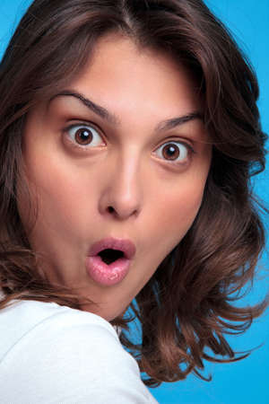 gasp: Portrait of an attractive young woman with a shocked expression of her face Stock Photo