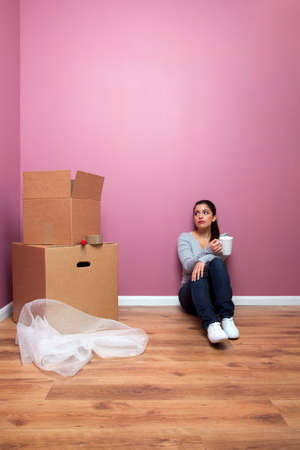 Young woman taking a break from packing during a home move. Plenty of copy space. Stock Photo - 4906155