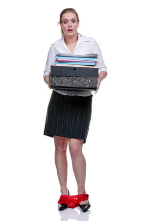 is embarrassed: A woman with her hands full carrying office files suddenly realises somethings not right, isolated on white background